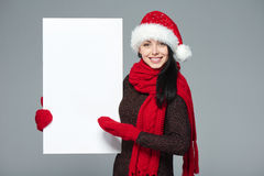 Woman in Santa hat holding white banner Stock Photography