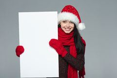 Woman in Santa hat holding white banner Royalty Free Stock Photo