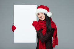 Woman in Santa hat holding white banner Stock Photos