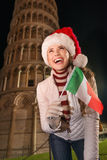 Woman in Santa hat with Italian flag near Leaning Tower of Pisa Stock Images