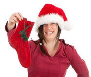 Woman in Santa hat keeping red sock Stock Photos