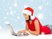 Woman in santa hat with laptop and credit card Stock Photos