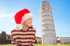 Woman in Santa hat looking on something near Leaning Tour, Pisa Stock Image