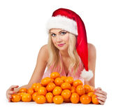 Woman in santa hat with mandarines Stock Photo
