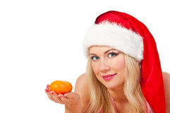 Woman in santa hat with mandarines Stock Photography