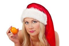 Woman in santa hat with mandarines Royalty Free Stock Photography