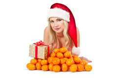 Woman in santa hat with mandarines Royalty Free Stock Image