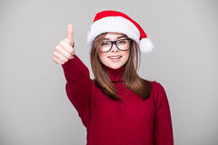 Woman with santa hat okey gesture. Woman with Christmas hat okey gesture Royalty Free Stock Images