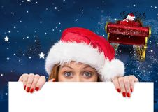 Woman in santa hat peeking from a blank placard 3D Royalty Free Stock Photography