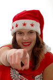 Woman in Santa hat pointing Stock Image
