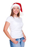 Woman in santa hat posing Stock Photo