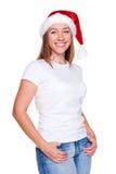 Woman in santa hat posing Stock Photo