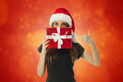 Woman in santa hat with red gift Royalty Free Stock Photo