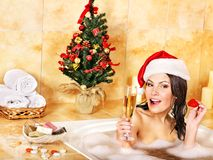 Woman in santa hat relax in bath. Stock Photo