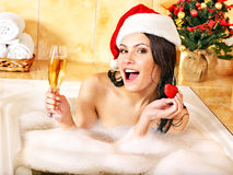 Woman in santa hat relax in bath. Royalty Free Stock Photos