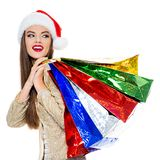 Woman in santa hat with shopping bags. stock photography