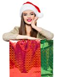 Woman in santa hat with shopping bags. stock image