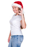Woman in santa hat showing ok sign Stock Photos