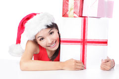 Woman in santa hat smile showing xmas gift Royalty Free Stock Photo