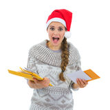 Woman in Santa hat surprised by lots of letter Stock Image