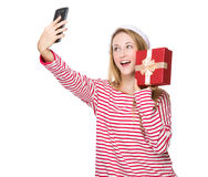 Woman with santa hat and take selfie with gift box Royalty Free Stock Image