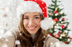 Woman in santa hat taking selfie at christmas Stock Photography