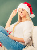 Woman in Santa hat thinking about Christmas Royalty Free Stock Photos