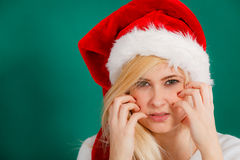 Woman in Santa hat thinking about Christmas Royalty Free Stock Photo