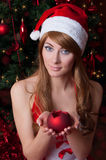 Woman santa helper with candle stock photos