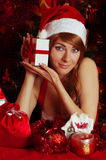 Woman santa helper with gift box stock photo