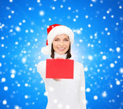 Woman in santa helper hat with blank red card Royalty Free Stock Photography