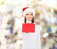 Woman in santa helper hat with blank red card Royalty Free Stock Images