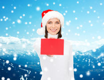 Woman in santa helper hat with blank red card Stock Photography