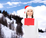 Woman in santa helper hat with blank red card Royalty Free Stock Photo
