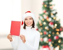 Woman in santa helper hat with blank red card Stock Photos