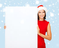 Woman in santa helper hat with blank white board Royalty Free Stock Image