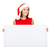 Woman in santa helper hat with blank white board Stock Photos