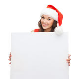 Woman in santa helper hat with blank white board Stock Photography