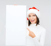 Woman in santa helper hat with blank white board Royalty Free Stock Photos