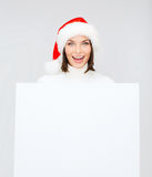 Woman in santa helper hat with blank white board Stock Image