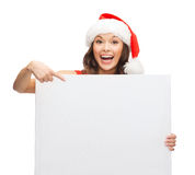 Woman in santa helper hat with blank white board Royalty Free Stock Photography