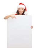 Woman in santa helper hat with blank white board Stock Images