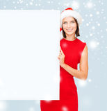 Woman in santa helper hat with blank white board Royalty Free Stock Photo