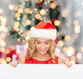 Woman in santa helper hat with blank white board Royalty Free Stock Images