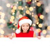 Woman in santa helper hat with blank white board Stock Image