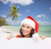 Woman in santa helper hat with blank white board Stock Photos