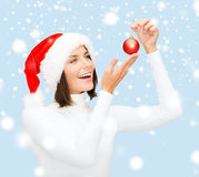 Woman in santa helper hat with christmas ball Stock Photography