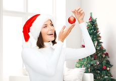 Woman in santa helper hat with christmas ball Stock Photo