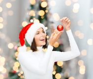Woman in santa helper hat with christmas ball Royalty Free Stock Photo