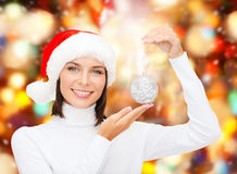 Woman in santa helper hat with christmas ball Royalty Free Stock Photography